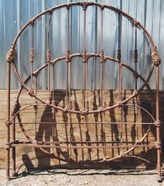 antique iron bed - We used old foot and head boards from iron beds as a fence in our garden.  As they rust they add  a great primitive look to my flower garden