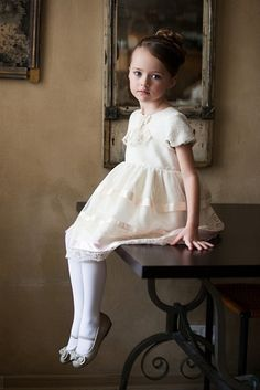 Hi, I'm Lizzie. Daughter of Rapunzel. I like to paint. I have a big brother named Drew. I'm 7. And really shy. Do you have any questions? anyway, I sew and bake. I like making dresses and fighting with Daddy.