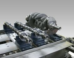 Camshaft / Crankshaft fixture on conveyor washer.