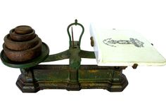 abulous antique scale with original green paint. Original transferware ironstone plate attached. Lettering is worn, but still present. Wear on plate, but no chips or cracks. Appears to be in working order, although accuracy is untested. Rare to find with the original weights and plate intact. Made by Avery Scale for Grove & Sons Company.