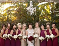 Blaire and her bridesmaids look lovely in shades of ivory champagne and burgundy!  Photography by @secondlinephotography  #thefloralcottageflorist #louisianabride #louisianaweddings #batonrougebride #batonrougewedding #nolaweddings #nolabride #neworleanswedding #hammondwedding #rosebouquets #rosewedding