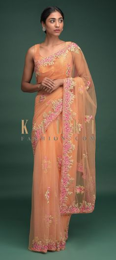 Buy Online from the link below. We ship worldwide (Free Shipping over US$100)  Click Anywhere to Tag Melon Peach Saree In Net With Resham Embroidered Floral Buttis And Border Online - Kalki Fashion Melon peach saree in net adorned with resham, sequins and zari embroidered floral buttis and border.Trimmed with tassels on the pallu.