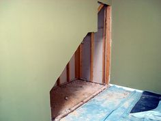 making use of space under a staircase: DIY home improvement.