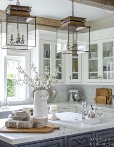 25 Classic Farmhouse Light Fixtures - White Kitchen with dark center island-glass kitchen cabinets-lantern pendant lights-wood beams in kitchen Kitchen Decorating, Home Decor Kitchen, Diy Kitchen, Kitchen Ideas, Awesome Kitchen, Kitchen Colors, Design Kitchen, Pottery Barn Kitchen, Kitchen Wood