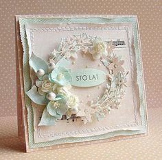handmade card by Dorota ... shabby chic ... r pale pastel in pink and aqua ... roughed up edges ... layered die cut twiggy wreath ... posey of artificial flowers ... machine stitching ... layers ... beautiful ...