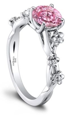 The Leah diamond engagement ring by Jeff Cooper. This unique design features a cherry blossom design along the band. Any cut of center stone would work with this setting; it is shown here with a round pink stone.