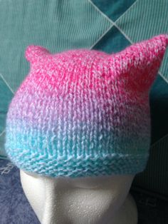 This beautiful, bright and colourful beanie hat, featuring cat or animal ears, will keep you ears and head warm while making sure you look adorable. I hand knit this hat using gorgeous double knit yarn in lovely pastel shades of pink, purple, blue and white. It measures approximately 22cm/9in in width, so 44cm/18in all the way around and 18cm/7in from top to bottom. I only have one of these hats available, but I can custom make a hat for you. Please contact me to discuss. I hav...