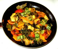 Ratatouille~  1 pound eggplant  salt  3 T olive oil  3 cloves garlic, chopped  2 medium onions, roughly chopped  3 T fresh basil, chopped  3 T fresh parsley, chopped  1 t oregano  ½ t rosemary  ½ t thyme  1 pound zucchini, cubed  1 red and 1 green bell pepper, seeded and chopped or sliced  2 large tomatoes, roughly chopped  black pepper