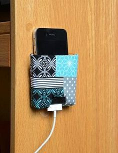 Keep your phone charged and within arm's reach by creating and mounting a custom made charging station in your dorm room. Keep charging phone off the bed to prevent fires!