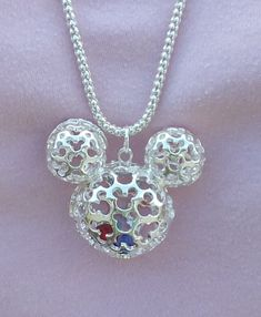 Disney Mickey Mouse Hidden Mickey Necklace Scrollwork Silver Mickey Pendant Beads by AOSDESIGN on Etsy https://www.etsy.com/listing/189289767/disney-mickey-mouse-hidden-mickey