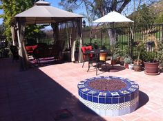 Outdoors Mexican Tile In A Firepit, Mexican Home Decor Gallery. Mission Accesories, Copper Sinks, Mirrors, Tables And More