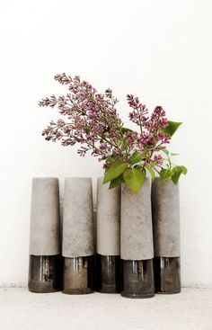 super cool metallic + cement vases. unfortunately no shipping to the us. guess i'll have to go to sweden!