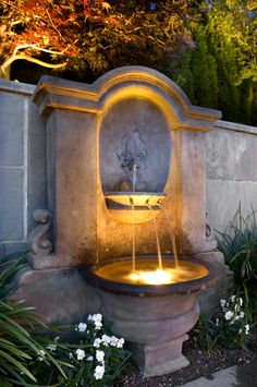 With spring right around the corner, adding a water feature such as this grand custom-built fountain can add beauty to any landscape. #customhomes #landscape #landscaping