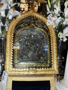 """Encased Our Lady of Tinos, Panagía Evangelístria Miracle Working Icon: the Virgin appeared to the nun St. Pelagia and revealed to her the place where the icon was buried. The icon is widely believed to be the source of numerous miracles...almost completely encased in silver, gold, & jewels, and is commonly referred to as the """"Megalócharē"""" (""""[She of] Great Grace"""") or simply the """"Chárē Tēs"""" (""""Her Grace""""). The icon was at the time thought to be the handwork of St. Luke the Evangelist... Tinos Greece, Luke The Evangelist, St Luke, Blessed Virgin Mary, Orthodox Icons, Mother Mary, Our Lady, Miraculous, Faith"""
