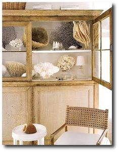 Fill a glass cabinet with shells, coral, driftwood for a nice display. Sand beach island nautical white linen offwhite neutrals natural dres...