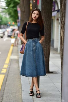Pair a fitted denim skirt with a loose cropped blouse. Or, go with a fitted top in an eye-catching pattern to balance out the mass of solid denim on the bottom.