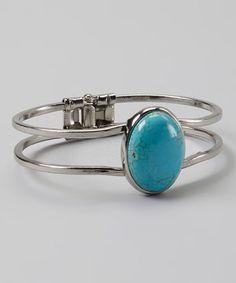 Embrace a sense of Southwest style with this simple bracelet flaunting a single stone and secure hinge fit.