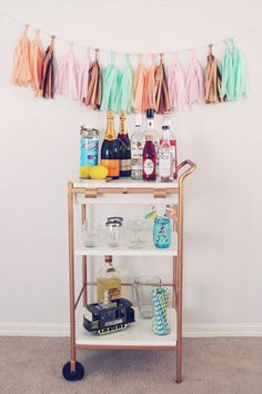 ikea bar cart DIY http://www.babble.com/home/bottoms-up-10-diy-bar-carts-hacks/ikea-utility-cart-hack/