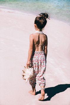 Backless floral romper, perfect for summer strolls! #estella #kids #fashion