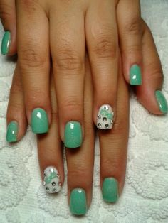 Mint Nails with single white accent nail with light green, mint, resin 3D bow, silver glitter tip line, clear crystals free hand nail art