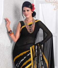 "If you are a true fashion cultivator of ethnic desires, this vogue collection of sarees from ""Ishya"" will help you to justify the needs of your insatiable soul. Perfectly accentuating your feminine grace with ease, this range liberates the aesthetics of Indian tradition through the diversified designs in grace and sophistication. Unleash your shopaholic attitude through this collection with fashionandyou.com.BRAND: IshyaCATEGORY: Printed Saree with Unstitched…"