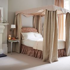 Dusky pink bedroom with draped four-poster bed | Bedroom decorating | Homes & Gardens | Housetohome.co.uk