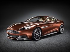 Aston Martin's Vanquish rides again - I honestly had no idea they were coming back out with the Vanquish.  Game OVER
