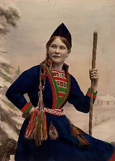 Sami woman~ i THINK she's holding a Narwhal tusk