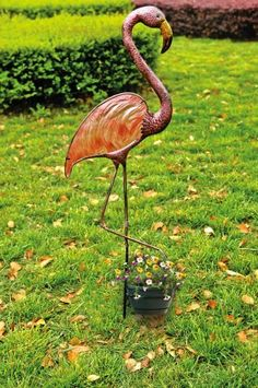 "51"" Flamingo Garden Stake,Glass and Metal,14x6.75x51.25 Inches by Outdoor Décor. $30.58. Made of painted glass and metal. Approximate dimensions are 14"" x 6.75"" x 51.25"". Weather resistant. Easily stakes into the ground. Great for yourself or as a gift. This decorative garden stake is crafted from high quality metal and glass, ensuring it will catch the eye of all who pass by for years to come!"