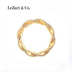 LeZari's hand woven micro pave rope eternity band is a simple and elegant selection with 1.15ct round diamonds set in 18k rose gold. This trendy ring can be mixed and matched with rose gold knuckle rings, solid bands, or worn simply as an individual ringlet.  Available now:$1,995.00