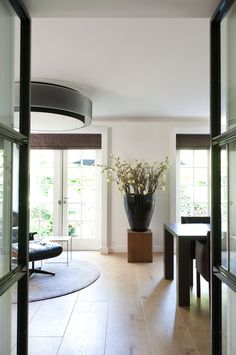 fill large black 'egg' shaped vase with Spring branches | Remy Meijers Interiors- villa in 'het gooi'