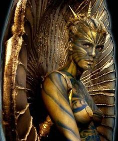 Golden Body Paint on Charlize Theron
