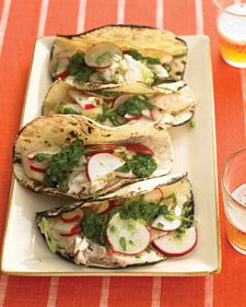 Fish tacos often involve deep-frying and heavy sauces. But here, broiled tilapia is topped with a crunchy radish salad and zingy cilantro-lime sauce -- fresher and tastier!