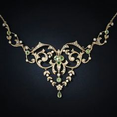 This lacy and feminine, turn-of-the-century, peridot and natural pearl necklace displays both Edwardian and Art Nouveau design characteristics. This ravishing and romantic gift comes nestled in its original heart shaped box - circa Bijoux Art Nouveau, Art Nouveau Jewelry, Jewelry Art, Fine Jewelry, Jewelry Necklaces, Jewelry Design, Fashion Jewelry, Fashion Earrings, Gold Jewelry