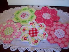 Pretty little fussy cut hexies :) would be cut set just like this for a table runner