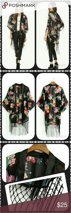 Sexy floral kimono top. Black with bright colorful flowers. Trimmed with satin. Long fringe along the bottom. Would be cute as a bathing suit cover up too. One size fits most. I would say that it would fit small - large comfortably. Boutique Chic  Tops