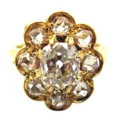 """Rare French Victorian Yellow Gold & Old Cut Diamond Cluster Ring. A rare version of a Victorian era """"cluster"""" ring. Made in France and composed of 18 karat yellow gold. Accompanied by a P.G.S. (Professional Gem Sciences Laboratory) Diamond Certificate stating that the center stone is a 1.52 Carat Antique Cushion Cut diamond. G-H in color grade & SI3 in clarity grade. Accented by eight (8) Round Rose Cut diamonds weighing 0.40 Ct. in total. Circa 1880"""