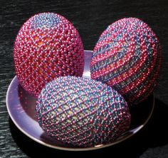 Open net beading on eggs in tones of pinks & blues.