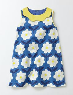 Feel as smart as the grown-ups at family get-togethers with this knee-length dress. Patch pockets are perfect for storing after-dinner sweets, while the fully lined cotton-mix fabric keeps you feeling comfortable while you sit through all the courses – then race into the garden afterwards to play.