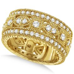 A total of eighty-six brilliant-cut round diamonds are elegantly set in a sparkling 14k yellow gold prong setting. The diamonds are very bright and are of G-H Color, SI1 Clarity.<p> The ring features milgrain edges for the ultimate designer's touch.<p> From our Byzantine Collection this wide band antique style ring is unlike any other. <p>Wear it as an anniversary band, as a statement ring, or as a right hand fashion ring!