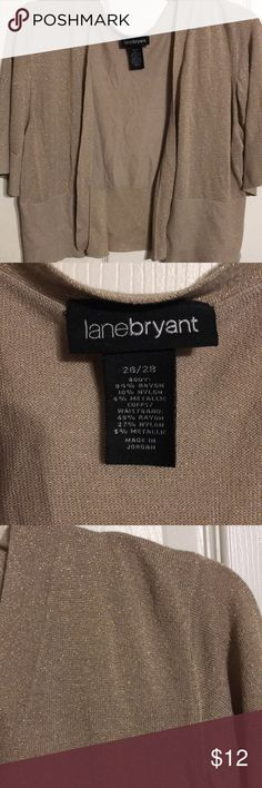 Lane Bryant gold Sweater jacket size 26/28 This is a short gold sweater jacket to wear over dresses or shirts Very sparkly with gold flakes Size 26/28 Lane Bryant brand Short sleeves  Very soft and dressy for a party or something Thanks for looking  Have a blessed Holiday Lane Bryant Sweaters Cardigans