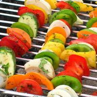 Summer Vegetable Skewer Recipe  _  Tri-colored bell peppers are the star of this colorful vegetable skewer recipe. The pepper's sweet, delicious flavor will soak into the zucchini, as the garlic-infused olive oil scents the earthy mushrooms. Vegetable skewers are a welcomed addition to any barbecue or cookout, and a great way to use fresh seasonal vegetables.