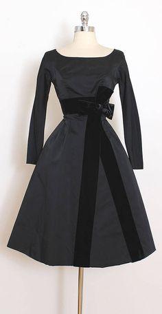 ➳ vintage 1950s dress * black satin * pellon lining * large black velvet bow * metal back zipper * by Beldon Cann condition | excellent fits like xs length 40 bodice 11 bust 34 waist 24 shoulders 16.5 sleeves 21.5 hem allowance 4.5 ➳ shop http://www.etsy.com/shop/millstreetvintage?ref=si_shop ➳ shop policies http://www.etsy.com/shop/millstreetvintage/policy twitter | MillStVintage facebook | millstreetvintage instagram | millstreetvin...