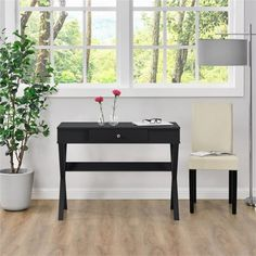 Enjoy the simple, yet sleek looking design of the Room & Joy Avena Campaign Desk in the comfort of your home. This compact Desk works perfectly in a home office or smaller spaces such as dorm rooms and apartments. You might even see fit that it's exactly what you were looking for in an entryway table or sofa table. This desk is not only versatile but it's constructed out of strong MDF boards for a beautiful, neutral look to fit in anywhere. Use the smooth top surface to keep your ...