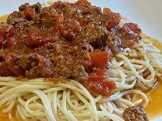 Sauce à spaghetti de Liza frulla - Ingrédients : 1/4 de tasse d'huile d'olive 1 petit oignon rouge haché fin 5 gousses d'ail hachées finement 1 lb de saucisses italienne 1 lb de b...