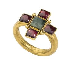 Early Christian Gemstone Ring,  4th–5th century, Roman. Gold, garnets, and emerald. Bezel 3 x 17 x 18 mm.; circumference 55 mm.; weight 4.2 gr. © The Metropolitan Museum of Art.