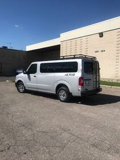 Silver 4x4 Nissan NV, Aluminess rack, Advanced 4x4 rear door ladder and rock sliders, 4x4 completed by Advanced.  Email or call us for a quote afwdconversions@gmail.com or 801-521-2334 4x4 Van Conversion, Nissan Vans, Off Road Camping, Rock Sliders, Four Wheel Drive, Ladder, Ford, Lake City, Car Stuff