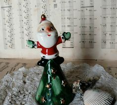 Check out this item in my Etsy shop https://www.etsy.com/listing/508208723/kitsch-vintage-santa-claus-bell-by-holt