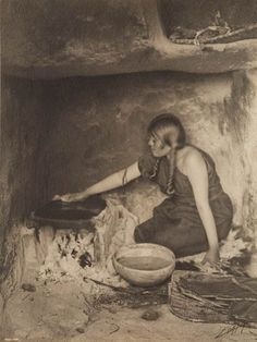 """Edward S. Curtis, """"The Piki Maker"""" The woman is seen cooking in her Hopi Native American pueblo over one hundred years ago, recalling a past that has almost been erased"""
