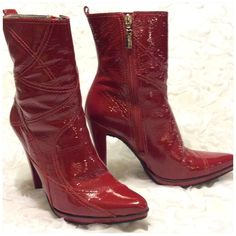 Gorgeous Carlos Santana Red Leather Boots These boots are absolutely stunning!! Size 8 Carlos Santana ankle boots in a rich cherry red patent leather with red stitch detailing and a red zipper with silver toned pull. 4 3/4 inch heel and a 1/2 platform that blends nicely into the boot. Very comfortable. Only worn twice. In almost new condition. The new only flaw I can find it n them is a tiny scratch on the tip of the left boot (shown in final photo). It is difficult to notice, smaller than…